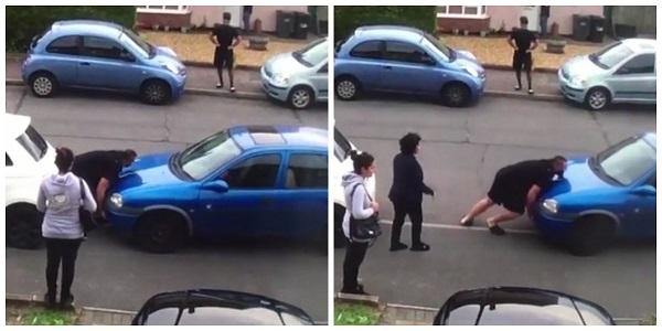 Homem, com os braços, retira carro que obstruía saída de garagem