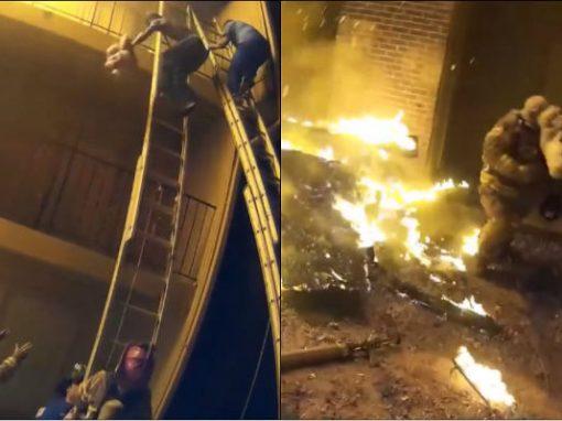 Criança é jogada de prédio em chamas e salva por bombeiros